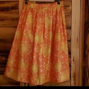 Juicy Oranges pleated midi skirt